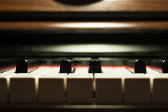 Piano keyboard detail. With warm light stock image