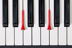 Piano keyboard and different golf balls and tees. Virtuosic game - Piano keyboard and different golf balls and wooden tees Royalty Free Stock Photography
