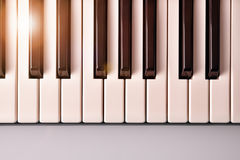 Piano keyboard with golden shine top view Stock Photo