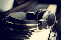 Piano keyboard and headphones. Piano keyboard with headphones for music stock images