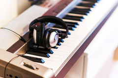Piano keyboard and headphones Stock Photography