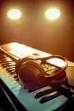 Piano keyboard with headphones Royalty Free Stock Image