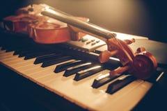 Piano keyboard with headphones Stock Photos