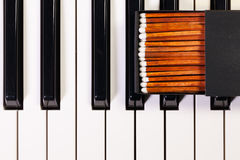 Piano keyboard and luxury matchbox Royalty Free Stock Photography