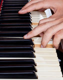 Piano keyboard made of ivory with hands Stock Image