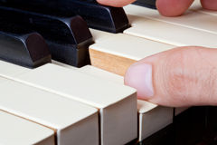 Piano keyboard made of ivory with hands Stock Images