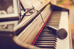 Piano keyboard and microphone, Close-up royalty free stock photo
