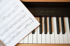 Piano keyboard and music book Royalty Free Stock Photo