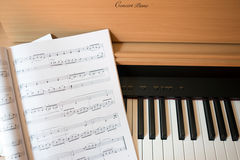 Piano keyboard and music book Royalty Free Stock Images