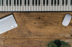 Piano keyboard on old wood desk Stock Images