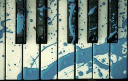 Piano keyboard with a painted stain royalty free stock photo