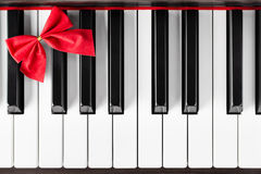 Piano keyboard with red ribbon Stock Photo