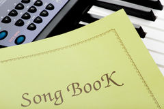 Piano keyboard with song book. Object on white - piano keyboard close up Royalty Free Stock Photos