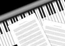 Piano keyboard with staff papers Royalty Free Stock Images