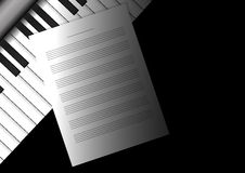 Piano keyboard with staff papers Royalty Free Stock Image