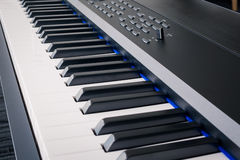 Piano Keyboard synthesizer closeup key frontal view Stock Photo
