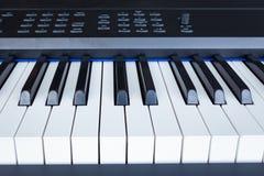 Piano Keyboard synthesizer closeup key frontal view Royalty Free Stock Photography