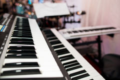 Piano keyboard. Two pianos used for a live concert Stock Photos