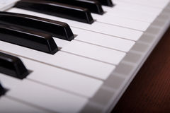 Piano keyboard. On the wooden background Royalty Free Stock Images