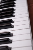 Piano keyboard. On the wooden background Royalty Free Stock Photography