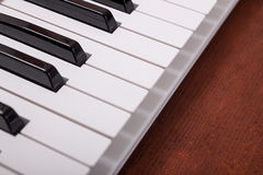 Piano keyboard. On the wooden background Royalty Free Stock Photo