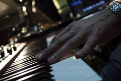 Piano Keyboards In Music Studio And A Hand Of A Musician. Piano Keyboards In Music Studio And  Hand Of A Musician Royalty Free Stock Photography