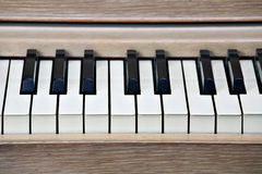 Piano keys. Closeup, framed by natural wood finish Royalty Free Stock Photo