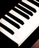 Piano Keys. Close up photograph of the bass / lower keys on a classical piano keyboard. Colors are black, white and brown. Room for text. Slight retro feel from Stock Photo