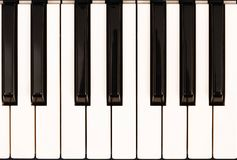 Piano keys. Closeup of piano keys viewed from above stock images