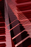 Piano Keys. Abstract of red white and black piano keyboard Royalty Free Stock Photos