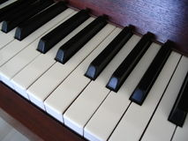 Piano keys. Angled view of piano keys Royalty Free Stock Image