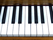 Piano Keys 2. Close-Up of Piano Keys and Dark Wood Royalty Free Stock Images