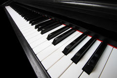 Piano keys. Close up of piano keys with red trim stock photos