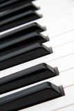Piano keys. Detail photo of black and white piano keys, tilted Royalty Free Stock Images