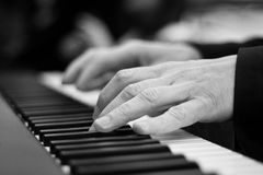 Piano keys. Close-up on a man's hand playing the piano Royalty Free Stock Images