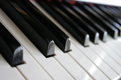 Piano Keys. A low angle view of the keyboard on a wooden piano Stock Photos