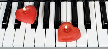 Piano keys. With two heart-shaped candles Royalty Free Stock Image