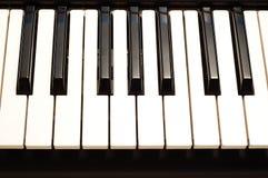 Piano keys. Close up Piano keyboard lit from above stock photos