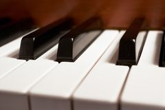 Piano Keys. A close-up of piano keys on an old piano with narrow DOF used Royalty Free Stock Photography
