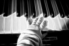 Piano keys with baby hands Royalty Free Stock Image