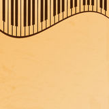 Piano keys on a beige grungy background Stock Images