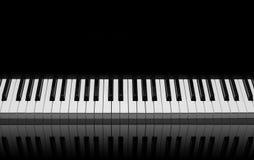 Piano keys. On black background Royalty Free Stock Image
