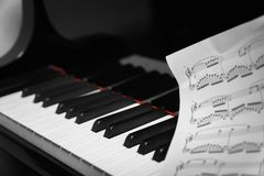 Piano keys on black classical grand piano Stock Image