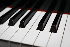 Piano keys on black classical grand piano Stock Photos