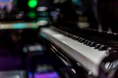 Piano keys on black classical grand piano. Play a classic song royalty free stock image