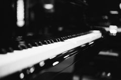 Piano keys on black classical grand piano. Play a classic song royalty free stock photos