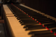 Piano keys on black classical grand piano. Play a classic song royalty free stock photo