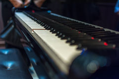 Piano keys on black classical grand piano. Play a classic song royalty free stock images