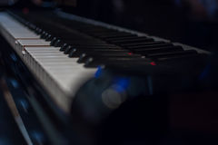 Piano keys on black classical grand piano. Play a classic song stock image