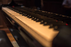 Piano keys on black classical grand piano. Play a classic song stock photos